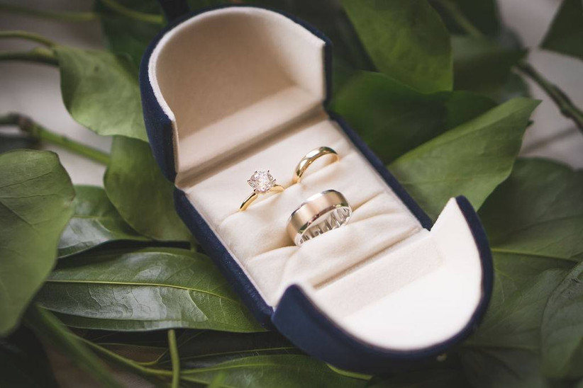 matching bridal engagement ring and wedding ring set in box with groom's wedding ring