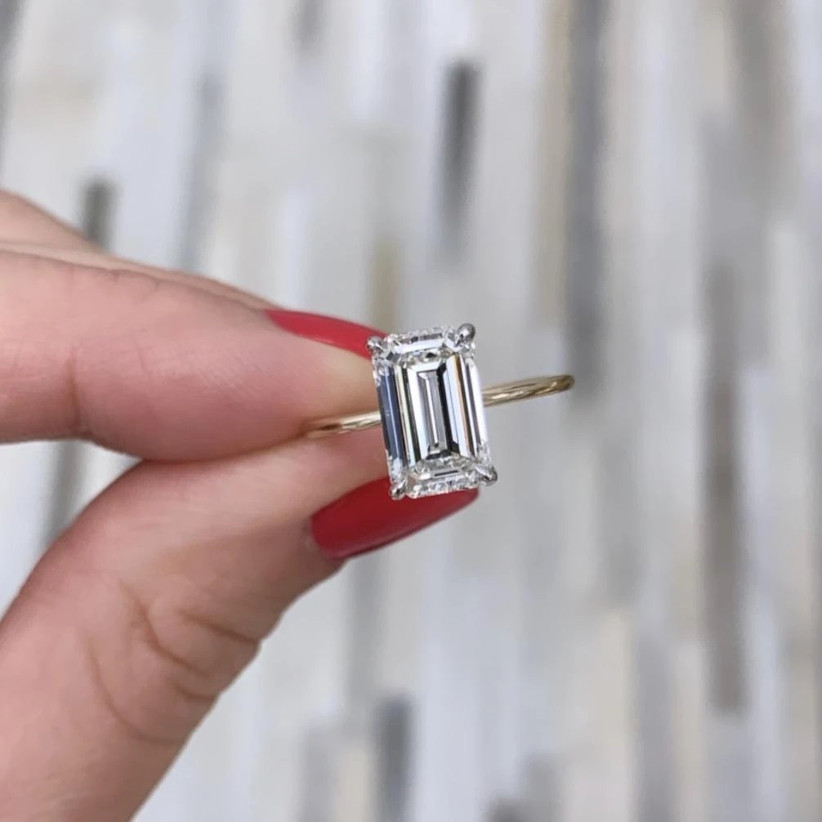 Stunning emerald-cut diamond on thin yellow gold band