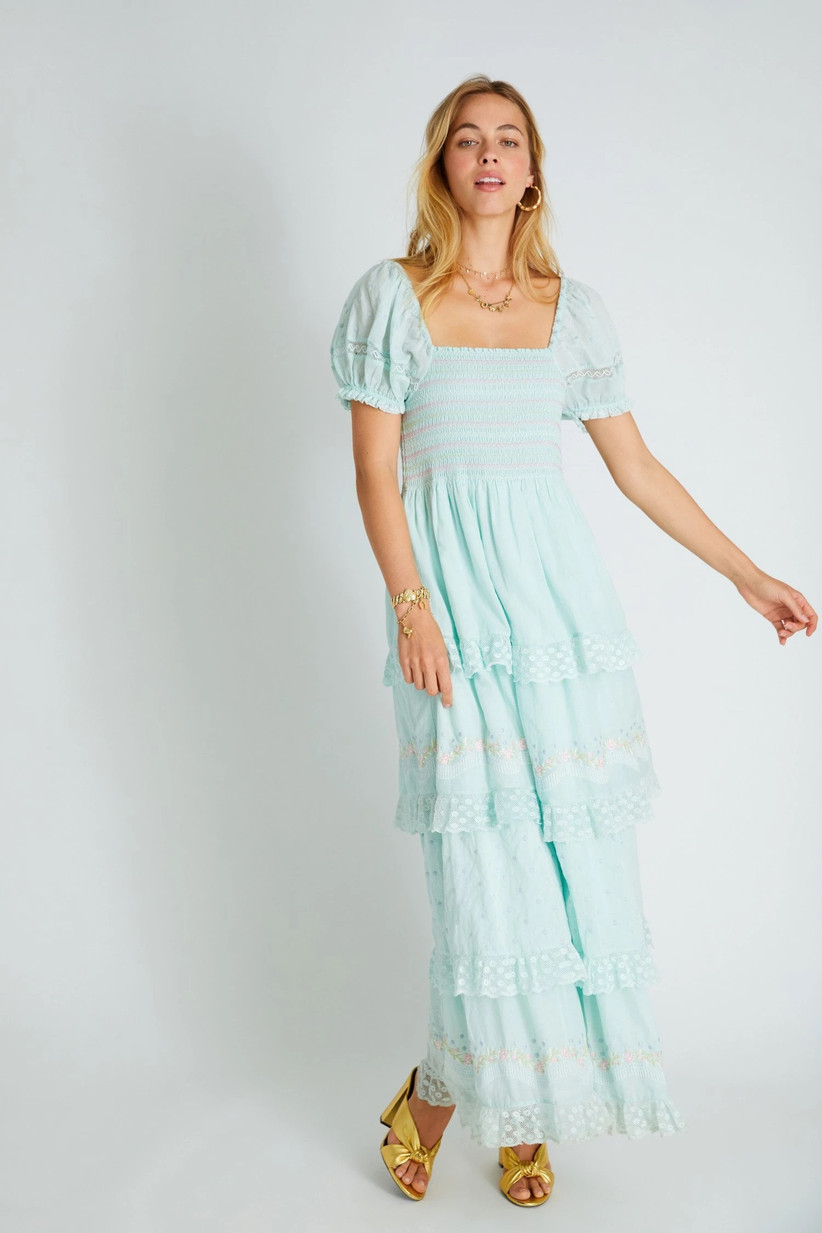 Model wearing boho pastel blue frock with lace tiers and puffed sleeves