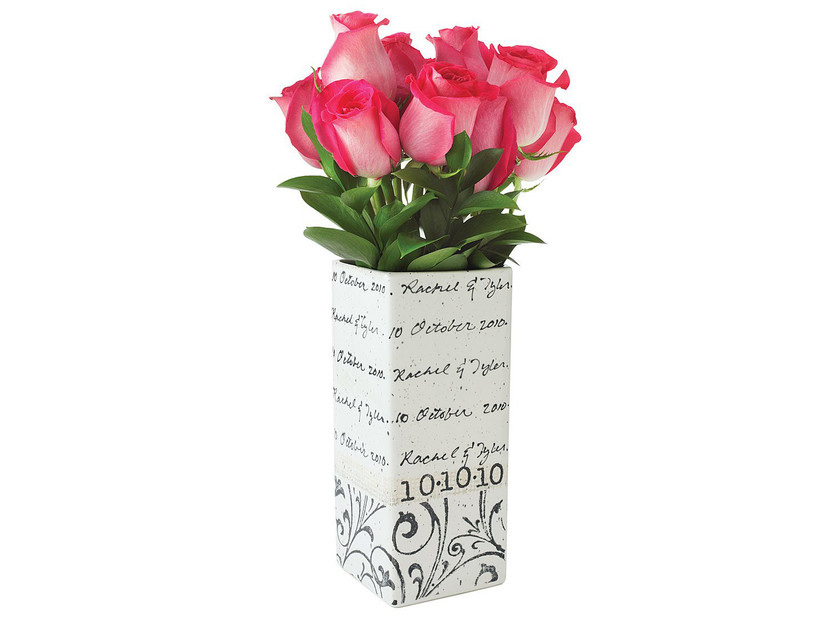 Rectangular white vase with couple's names and wedding date in black cursive