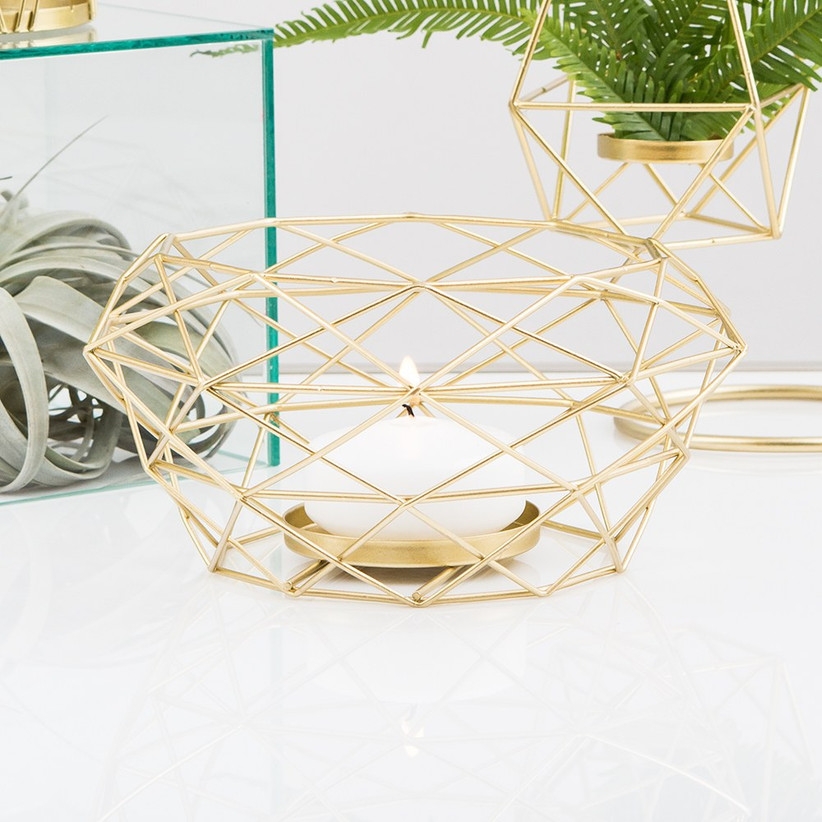 Tealight candle engagement party centerpiece with gold geometric cage