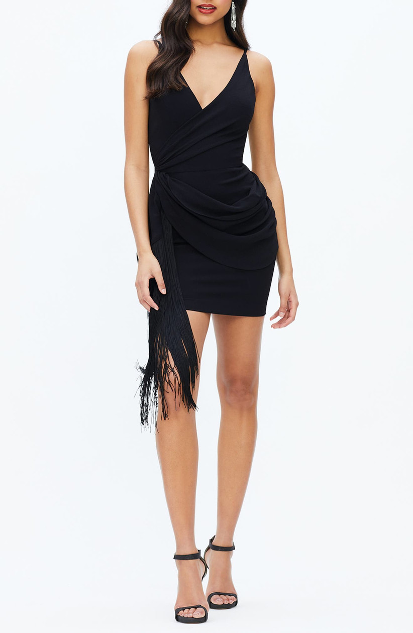 black bachelorette party dress miniskirt with draped bodice and long fringe sash on one side