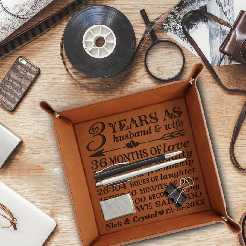 leather trinket tray with 3 years engraved on it