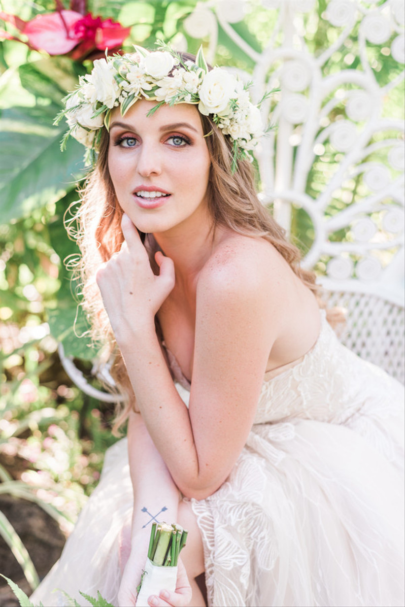 blonde bride wearing white and greenery flower crown