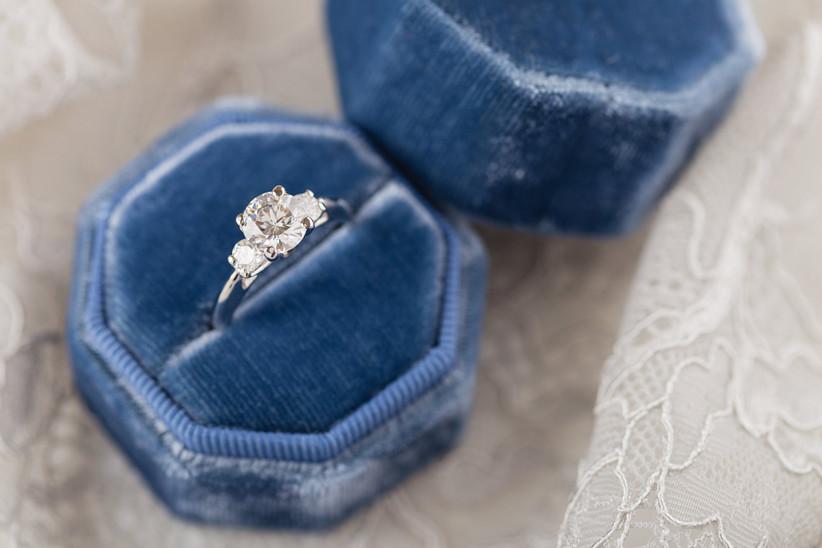 three stone engagement ring in blue velvet ring box