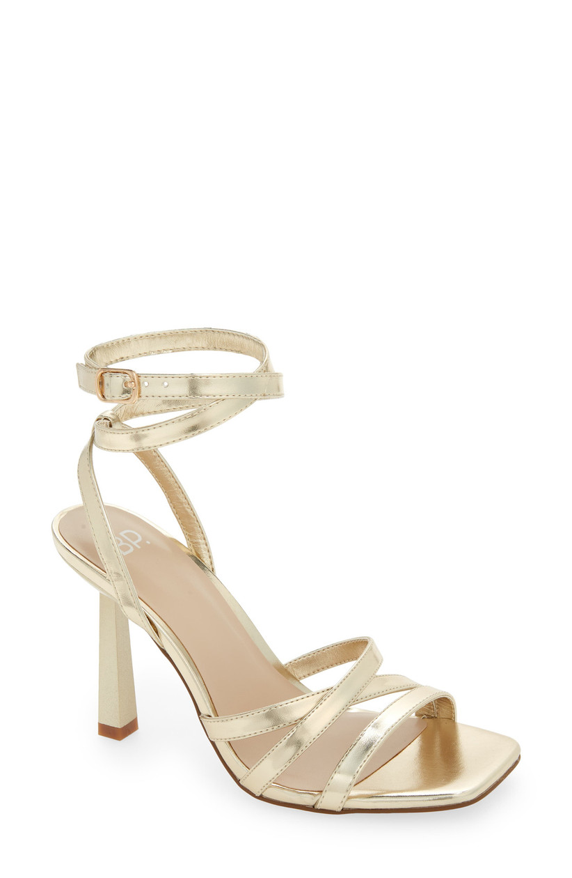 gold mid height sandal with criss cross straps