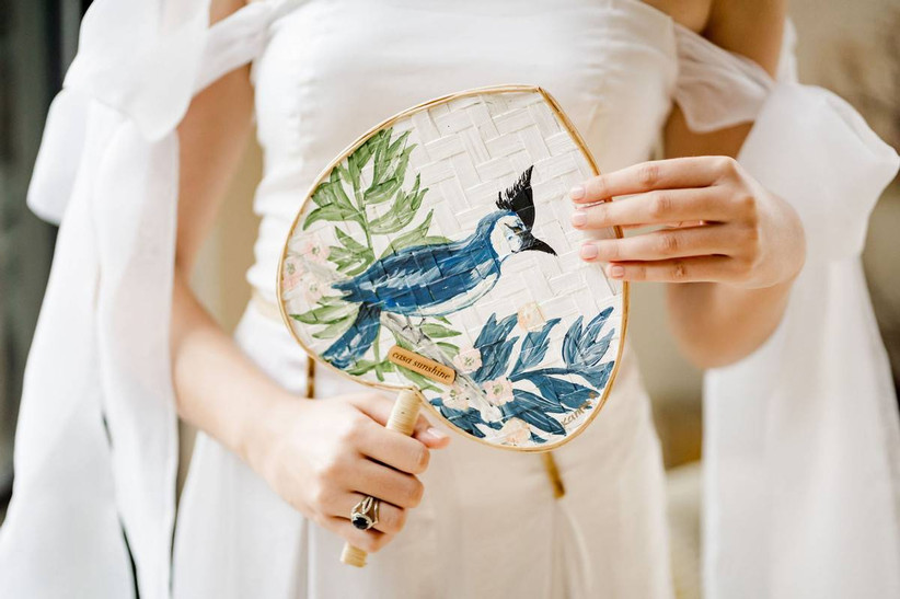 heart-shaped palm fan painted with blue jay bird and greenery