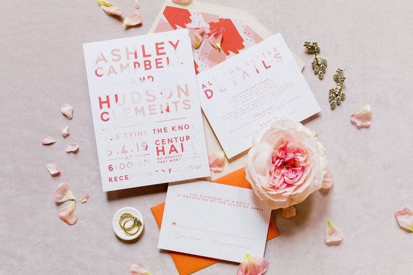 wedding invitations with block lettering and abstract light and dark pink design