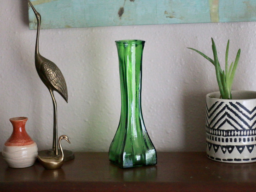 green vase on table