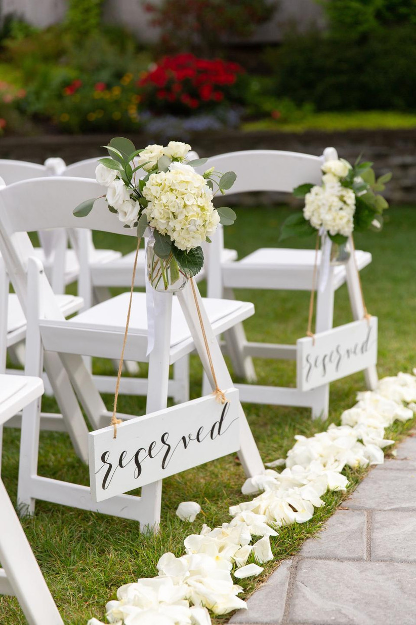 outdoor wedding aisle decor reserved seating signs with hydrangea and greenery aisle markers