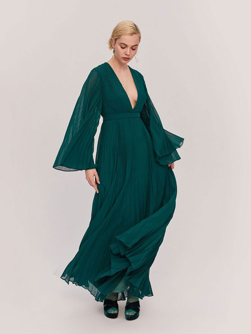 Vibrant forest green pleated bell-sleeve maxi dress for winter wedding guest