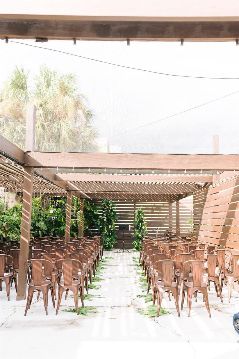 boho outdoor wedding aisle decor idea greenery palm leaves along the sides of the aisle