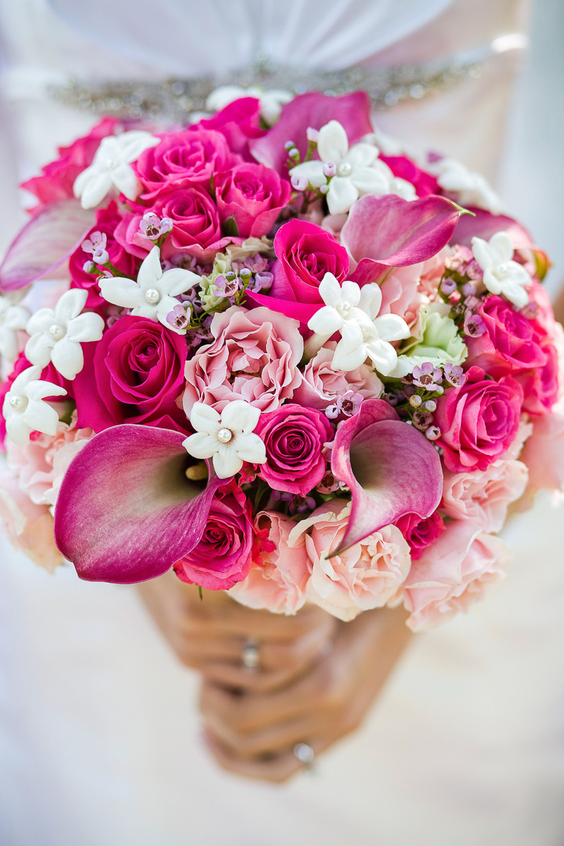 wedding bouquet of pink roses, calla lilies, and white stephanotis