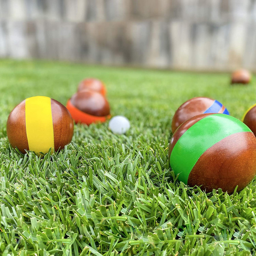 wooden bocce balls on grass