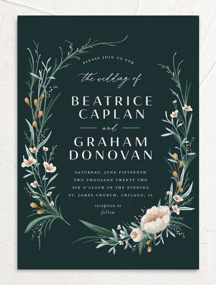 spring wedding invitation with dark green background and blush pink floral border