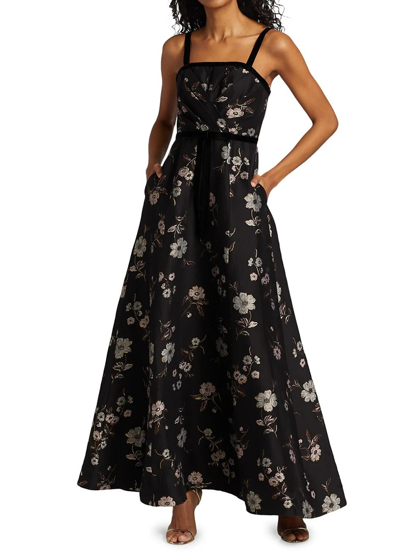 Model wearing black velvet strap floral maxi dress with metallic florals and pockets