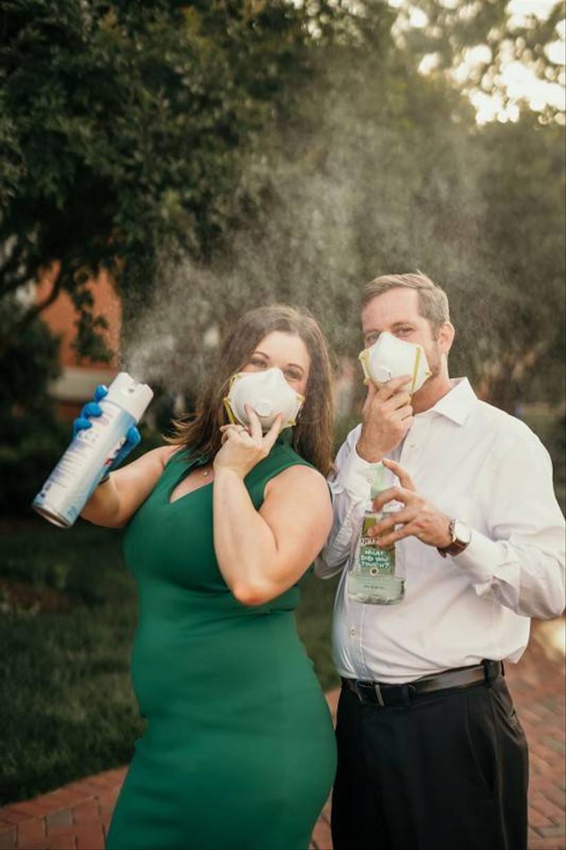 covid wedding couple holding disinfectant spray