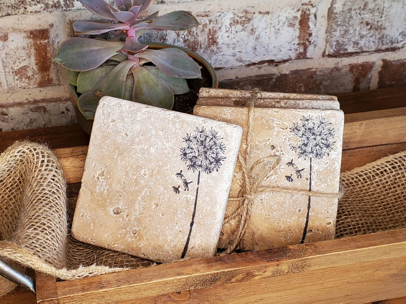 Rustic stone dandelion coaster set in a wooden tray