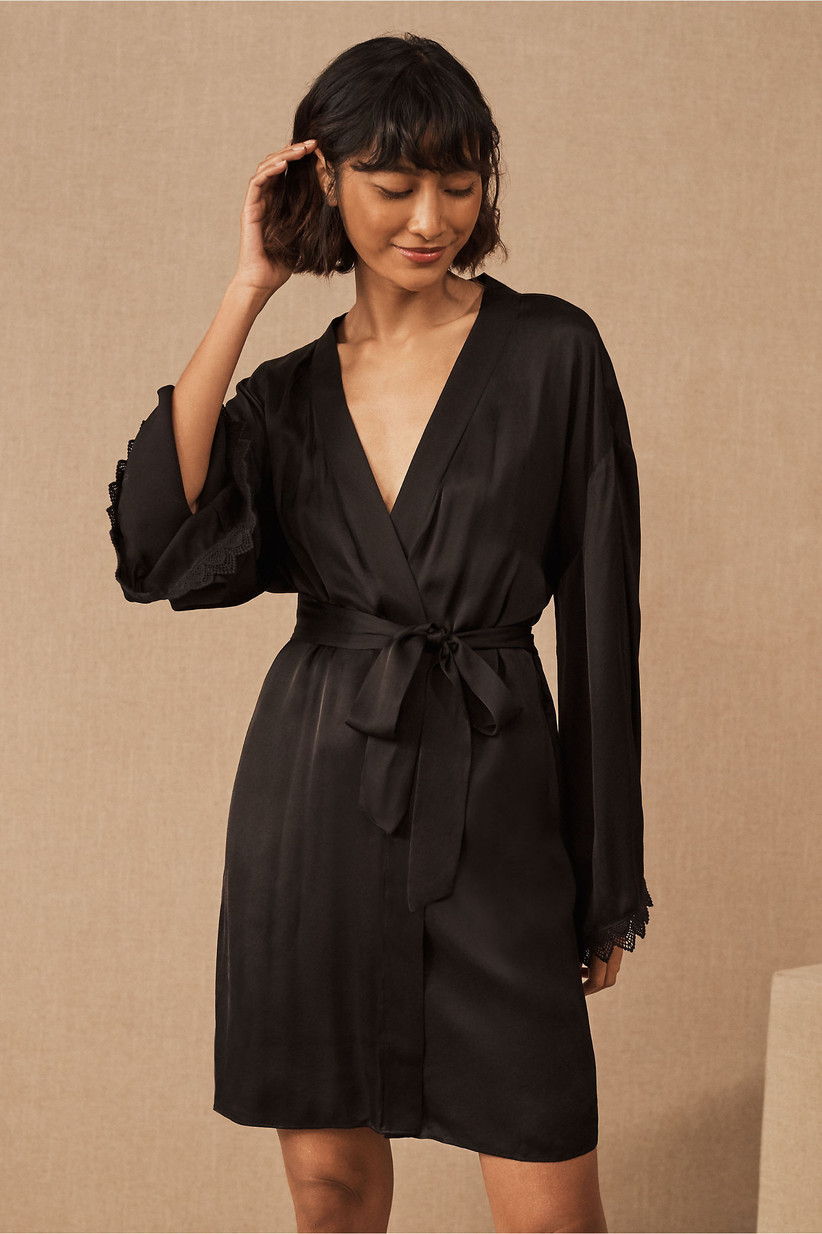 Short black bridal robe with lace trim on sleeves
