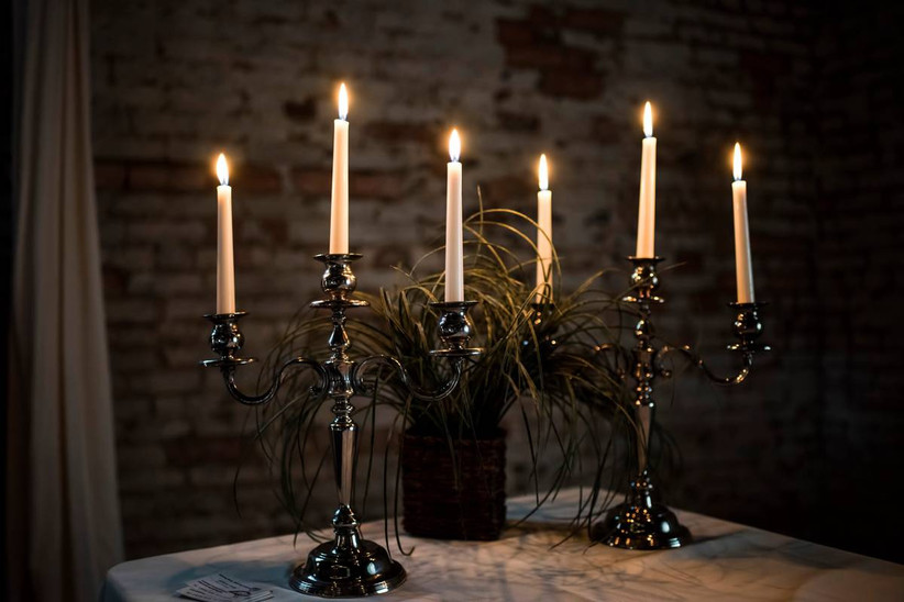 halloween themed wedding idea black candelabras with white taper candles