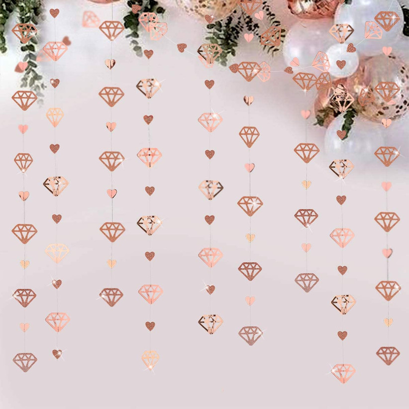 Rose gold diamond and heart handing garland engagement party backdrop