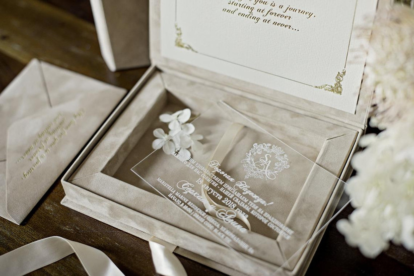 boxed wedding invitation featuring clear acrylic invitation in a velvet box with ribbon