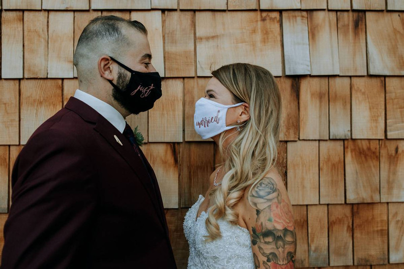 groom and bride wearing just married face masks