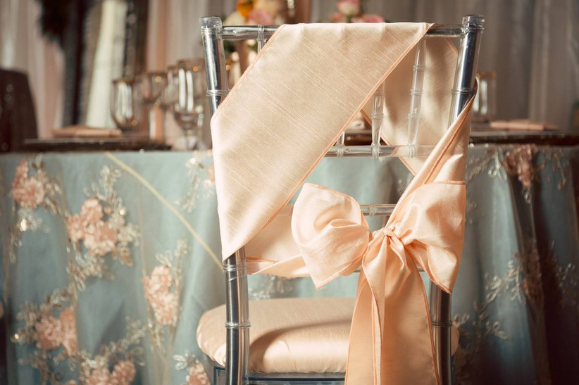 clear acrylic Chiavari chair decorated with blush pink bow