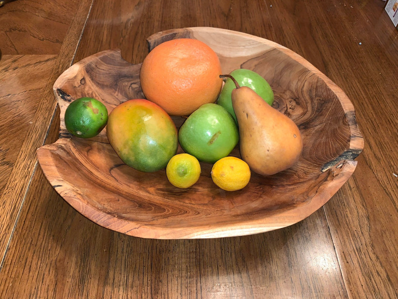 wooden bowl filled with fruit