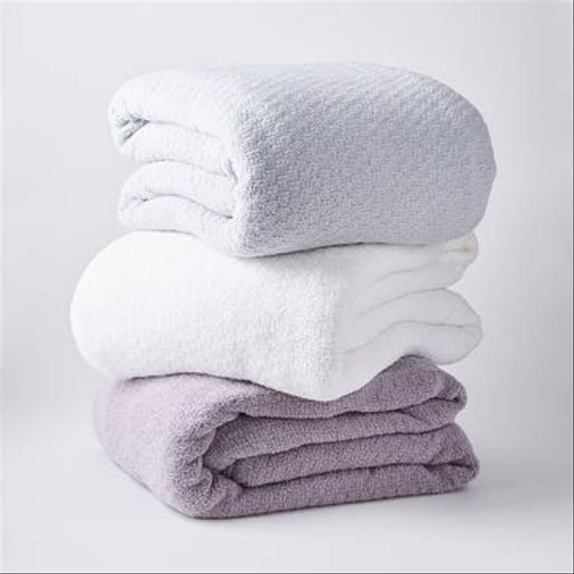 stack of three weighted blankets