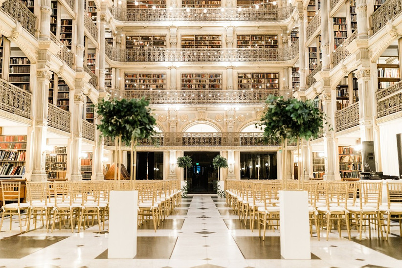 glamorous wedding venue — multi-story historical library at Johns Hopkins Peabody Institute. the bottom floor is surrounded by three levels of wraparound balconies