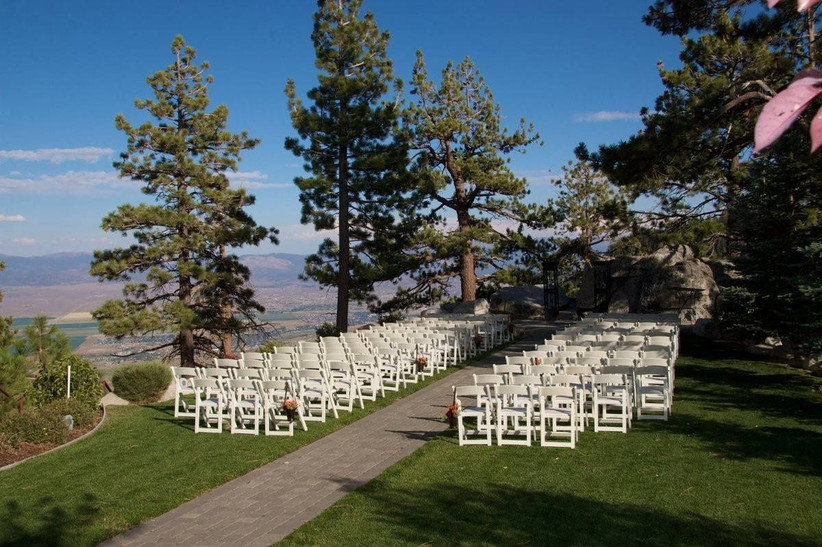 outdoor wedding ceremony surrounded by pine trees overlooking mountains