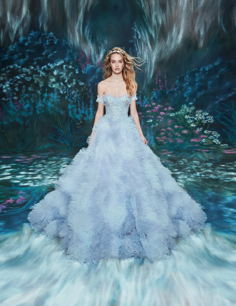 light blue tulle ball gown with skirt made from micro-ruffles and dramatic train