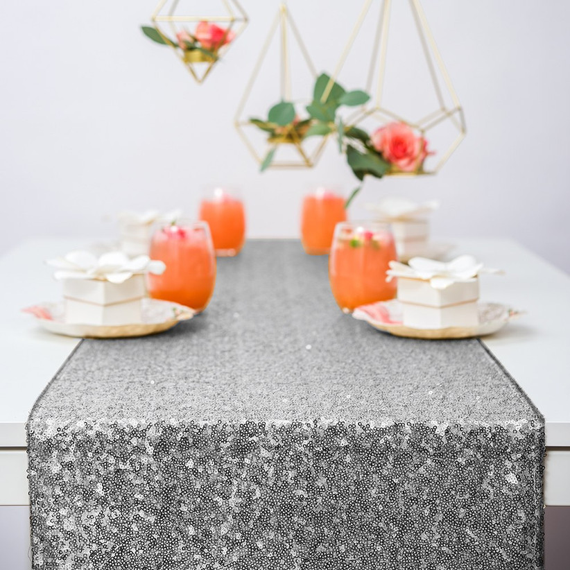 Table decorated with silver sequin table runner
