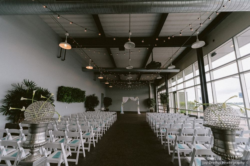 indoor industrial wedding ceremony with large windows on right