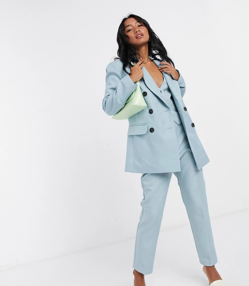 Blue three-piece suit rehearsal dinner outfit