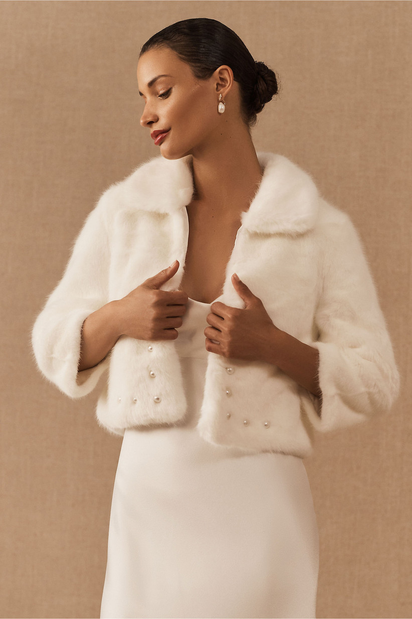 cropped ivory faux fur bridal jacket with 3/4 sleeves and pearl buttons