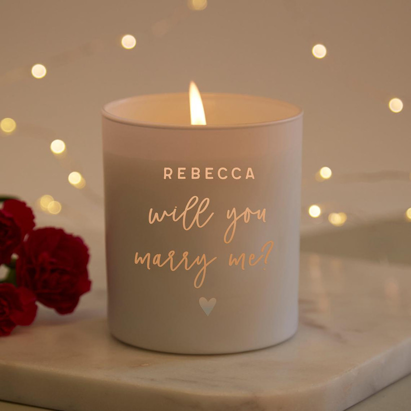 Personalized proposal candle that reads Rebecca Will You Marry me