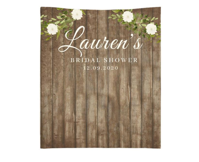 Rustic faux bois backdrop on a white background that reads Lauren's Bridal Shower