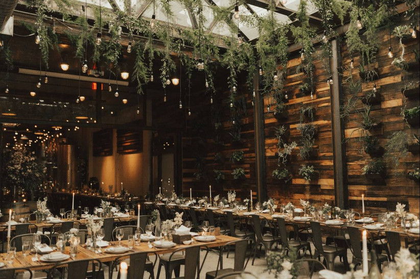 brooklyn winery wedding venue with walls covered in plants and industrial fixtures