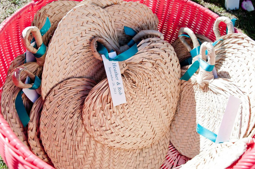 woven fans with tags that say couple's names and wedding date