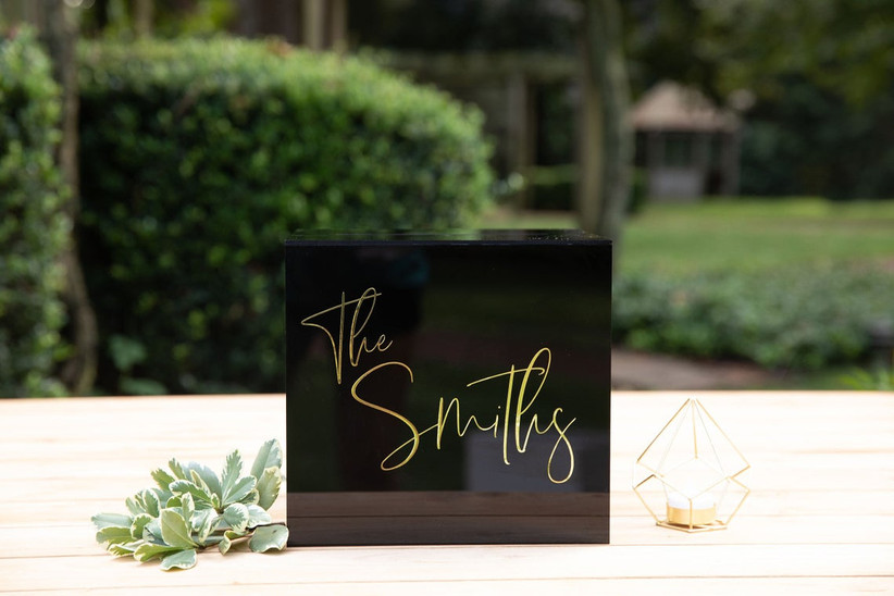 modern black acrylic wedding card box with couple's last name written in gold script