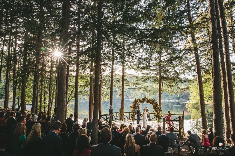 wedding ceremony in the woods overlooking the lake