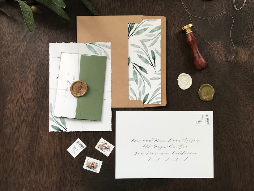 rustic greenery winter wedding invitations with deckled edge and gold wax seal