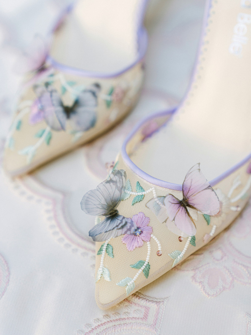 ornate wedding high heels with sheer netting embroidered with flower vines and butterfly appliques