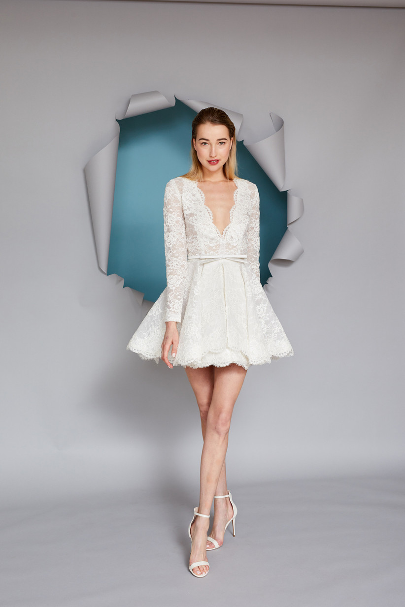 short lace wedding dress with long sleeves and flared skater skirt