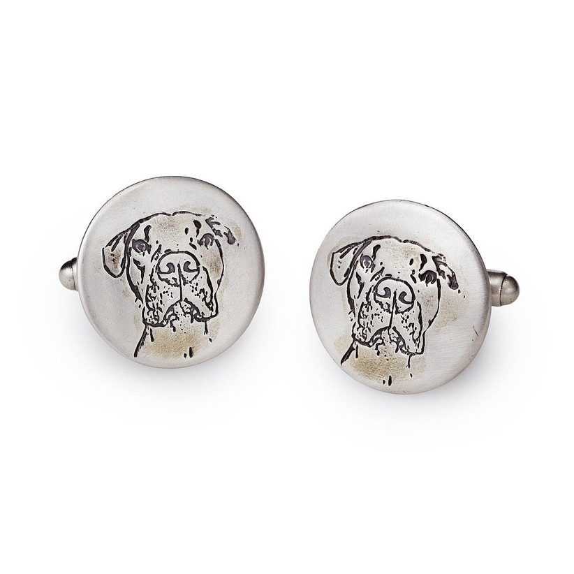 Round metal cuff links engraved with portrait of a dog