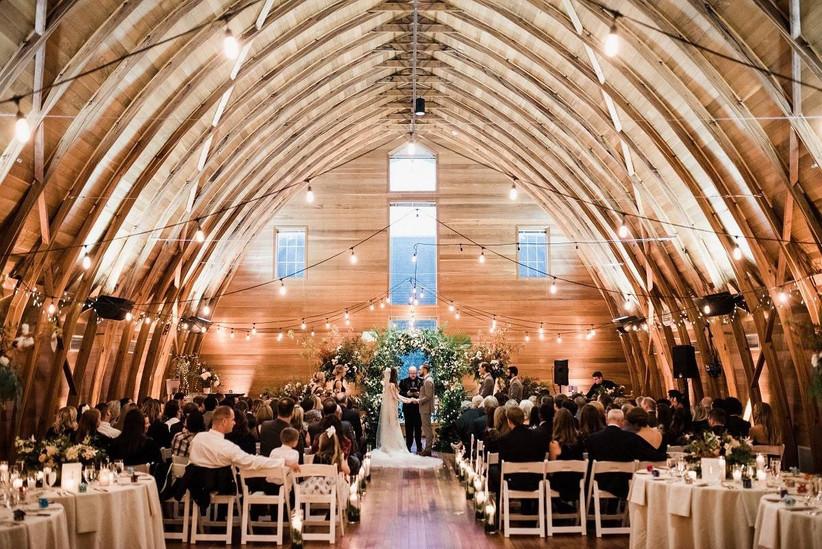 indoor wedding ceremony with wooden vaulted ceiling