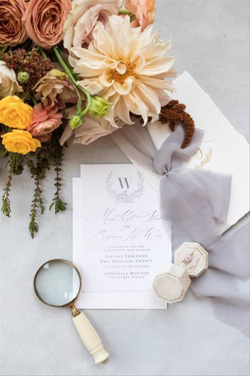 wedding invitation with velvet ring box and vintage magnifying glass