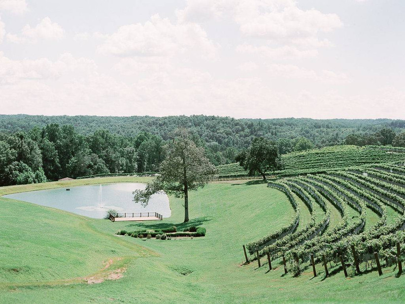 aerial view of winery wedding venue with vineyards and lake nearby